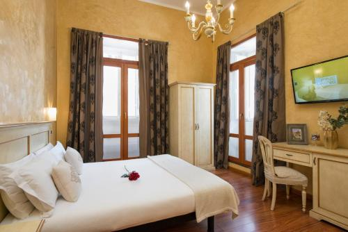 A bed or beds in a room at Navona Tower Relais
