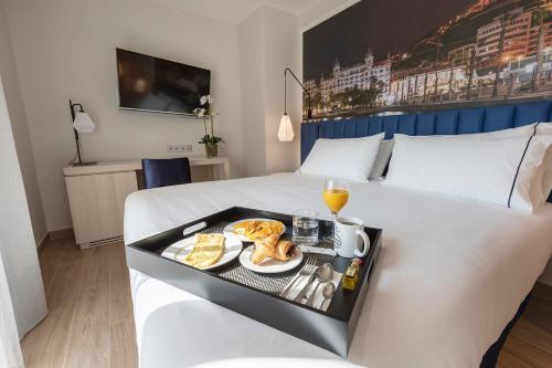 Cama o camas de una habitación en Eurostars Mediterranea Plaza