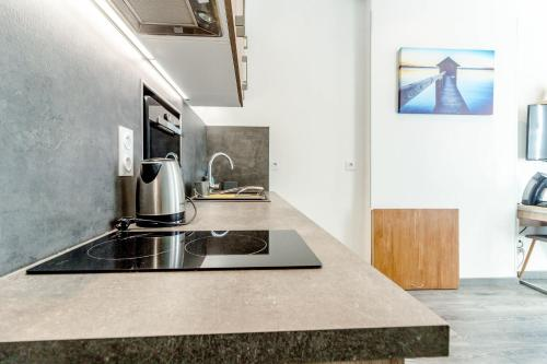 A kitchen or kitchenette at Cozy modern studio in the heart of Baille district in Marseille Welkeys