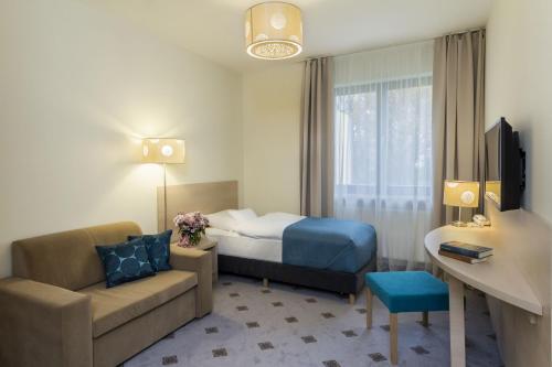 Łóżko lub łóżka w pokoju w obiekcie Hotel Notabene