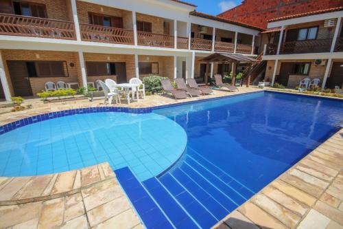 The swimming pool at or close to Pousada Coqueiro Verde- Prospar Administradora