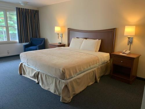 A bed or beds in a room at High Seas Motel