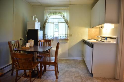 A kitchen or kitchenette at Acadia Pines Motel