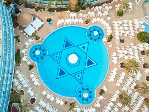 A view of the pool at Mediterranean Palace or nearby