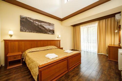 Кровать или кровати в номере Маунтин Виллас