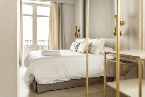 Ein Bett oder Betten in einem Zimmer der Unterkunft Wey´s Home Suites
