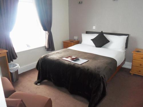 A bed or beds in a room at Novello B&B