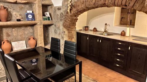 Кухня или мини-кухня в Apartamentos Rurales La Casa de Luis