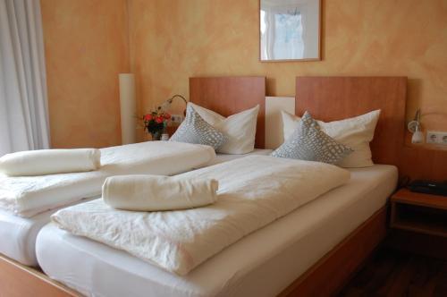 Ein Bett oder Betten in einem Zimmer der Unterkunft Hotel Landhaus Appel