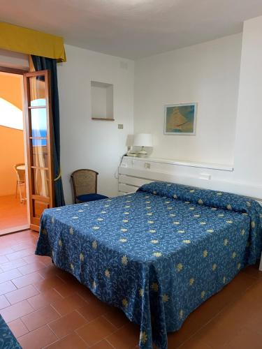 A bed or beds in a room at Albergo Le Briciole