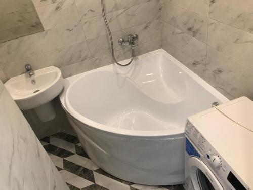Ванная комната в Apartment Studia Versal Na Nesebrskoy 14