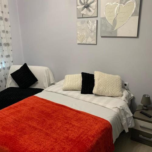A bed or beds in a room at La Rosa Azul Rooms