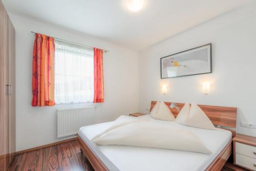 سرير أو أسرّة في غرفة في شقق ألبنجويل