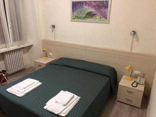 Кровать или кровати в номере Antico Albergo