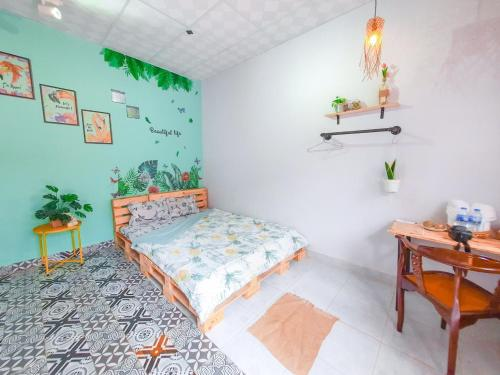 A bed or beds in a room at Green Sunshine