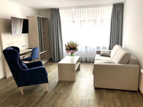 Ein Sitzbereich in der Unterkunft Hotel Kranenborgh