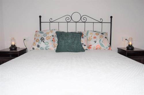 A bed or beds in a room at La Palma Nature Relax