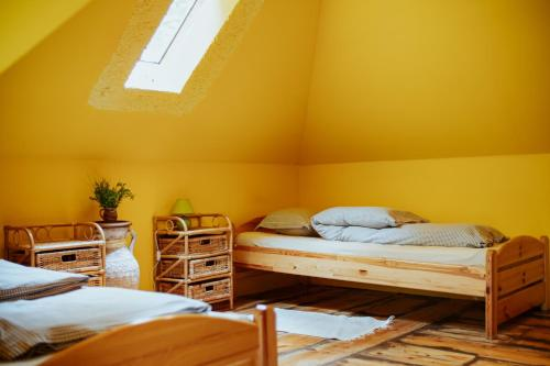 A bed or beds in a room at Kempings Ievlejas