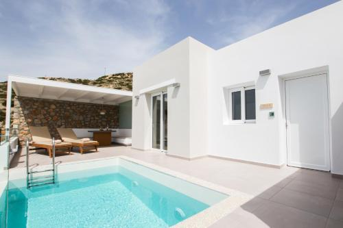 The swimming pool at or near Theros Luxury Villas
