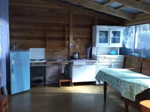 A kitchen or kitchenette at Байкальский уют