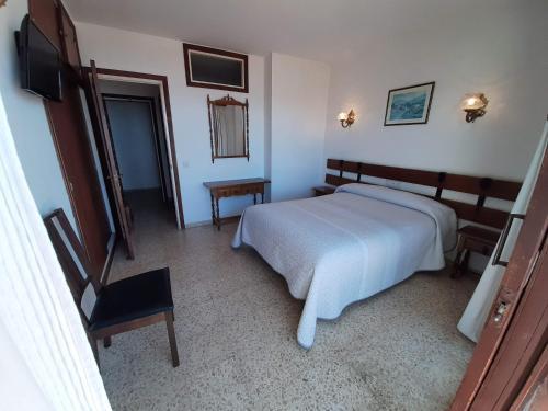 Säng eller sängar i ett rum på Hotel Buenavista