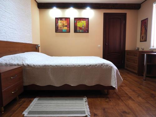 Кровать или кровати в номере apartment na Zavetnoi