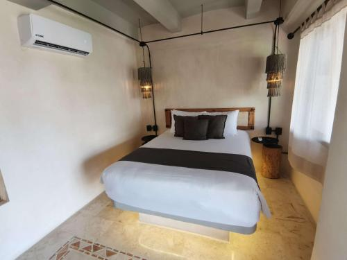 A bed or beds in a room at Caribbean Paradise Boutique Hotel
