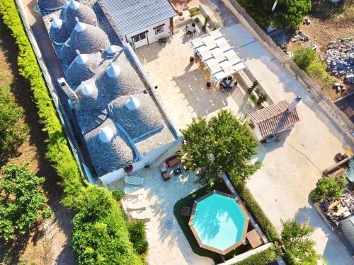 A view of the pool at Trulli Fenice or nearby