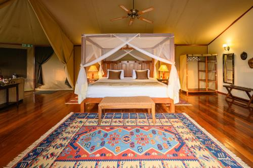 A bed or beds in a room at Olare Mara Kempinski