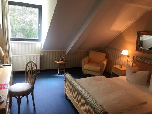 A bed or beds in a room at Burg Wegberg Hotel & Events