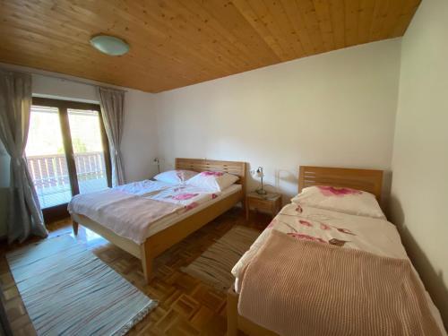 Posteľ alebo postele v izbe v ubytovaní Apartments-Rooms Kocijancic