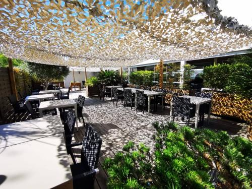 Restaurant ou autre lieu de restauration dans l'établissement Kyriad Prestige Montpellier Ouest - Croix D'argent - A709