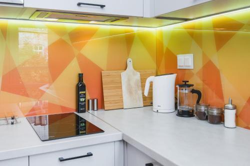 Kuchyň nebo kuchyňský kout v ubytování Modern, well organised place in city centre by Homeclick