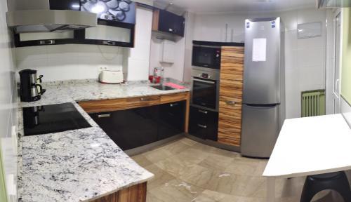 Cuina o zona de cuina de Acà Y Allà Apartamento Alfonso El Batallador