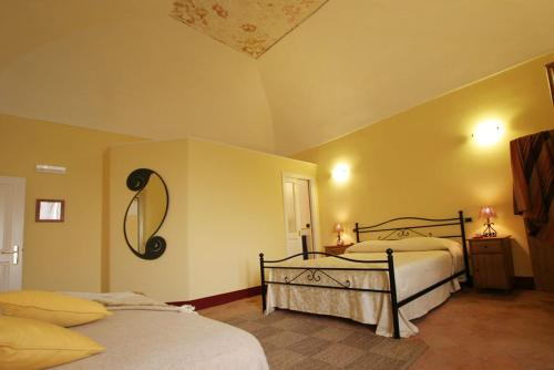 A bed or beds in a room at Palazzo Verone