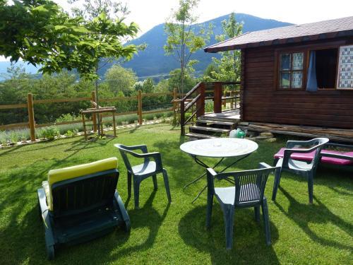 A garden outside Camping à la Ferme de Bourras