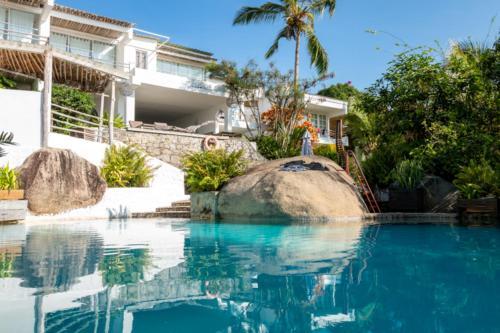 Der Swimmingpool an oder in der Nähe von Bliss Boutique Hotel Seychelles