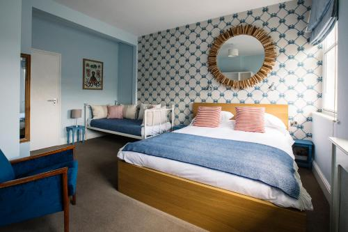 A bed or beds in a room at The Queens Hotel St Ives