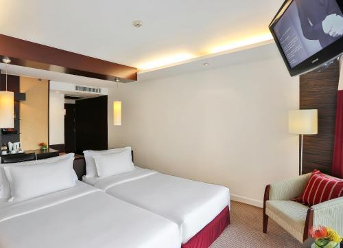 Łóżko lub łóżka w pokoju w obiekcie Eastin Hotel Makkasan, Bangkok