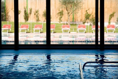 The swimming pool at or near Garda Sporting Club Hotel