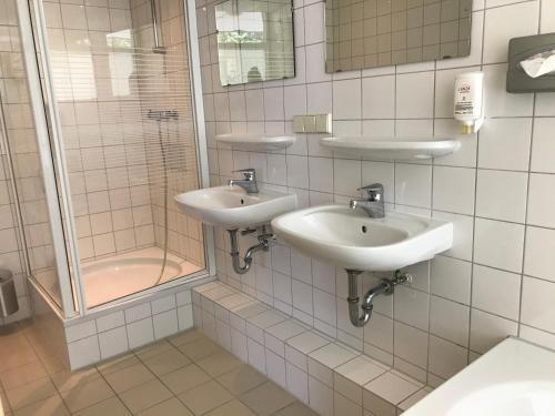 Ein Badezimmer in der Unterkunft Fletcher Strandhotel Renesse