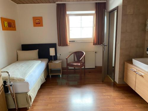 A bed or beds in a room at Pension Timeout