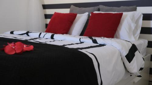 A bed or beds in a room at Chalet do Descanso