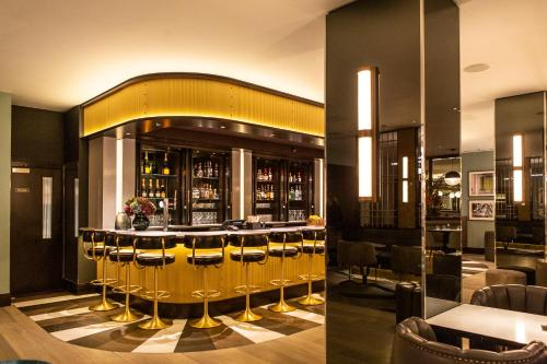 The lounge or bar area at Strand Palace Hotel
