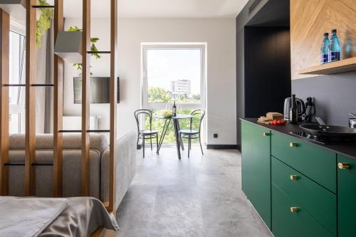 A kitchen or kitchenette at TOP Garden Aparthotel