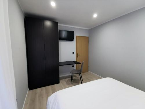 A bed or beds in a room at Upper Sea View Apartments