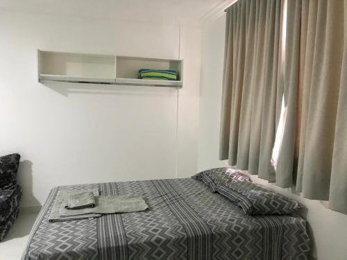 A bed or beds in a room at Studio com AR - UEM e Novo Centro