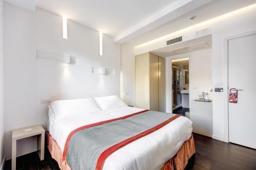 Ein Bett oder Betten in einem Zimmer der Unterkunft Albergo Abruzzi