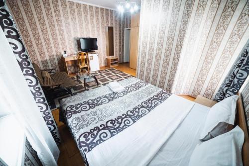 Кровать или кровати в номере Санрайз Гостевой Дом
