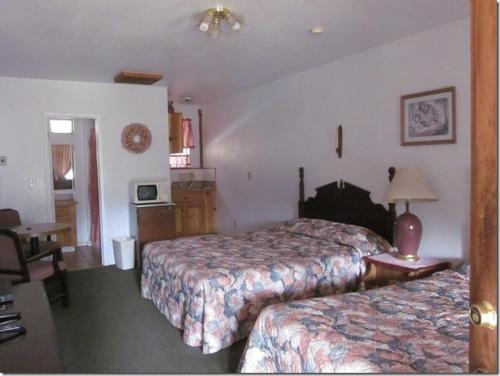 A bed or beds in a room at Bear Creek Cabins